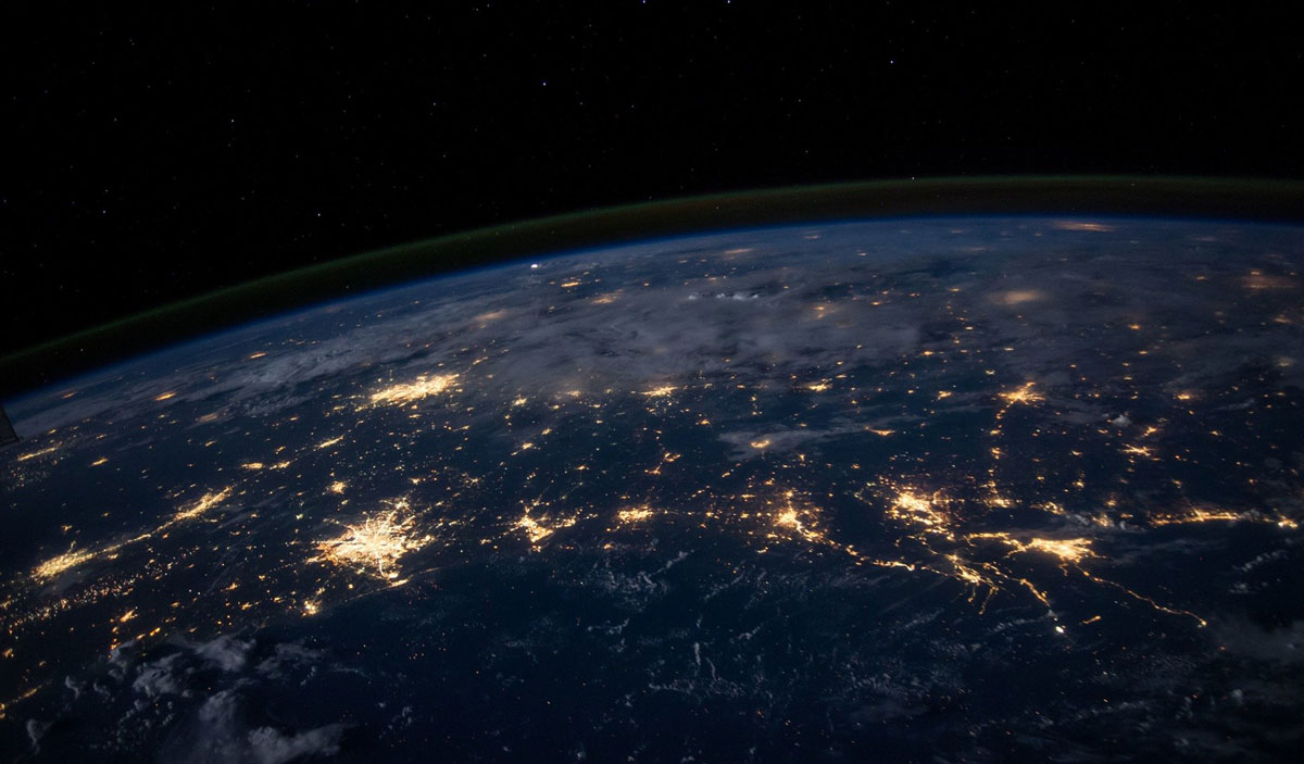Image showing earth landscape from space with the cities lit up during night time