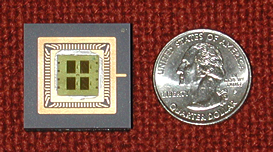 The glass microchip on the left measures 3 centimeters across—slightly more than the diameter of a quarter on the right—and is divided into four nanosoccer playing fields.