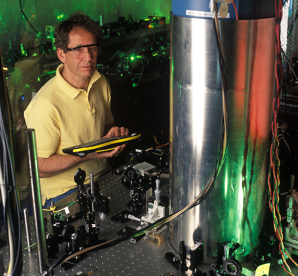 NIST physicist Jim Bergquist with the mercury-ion atomic clock