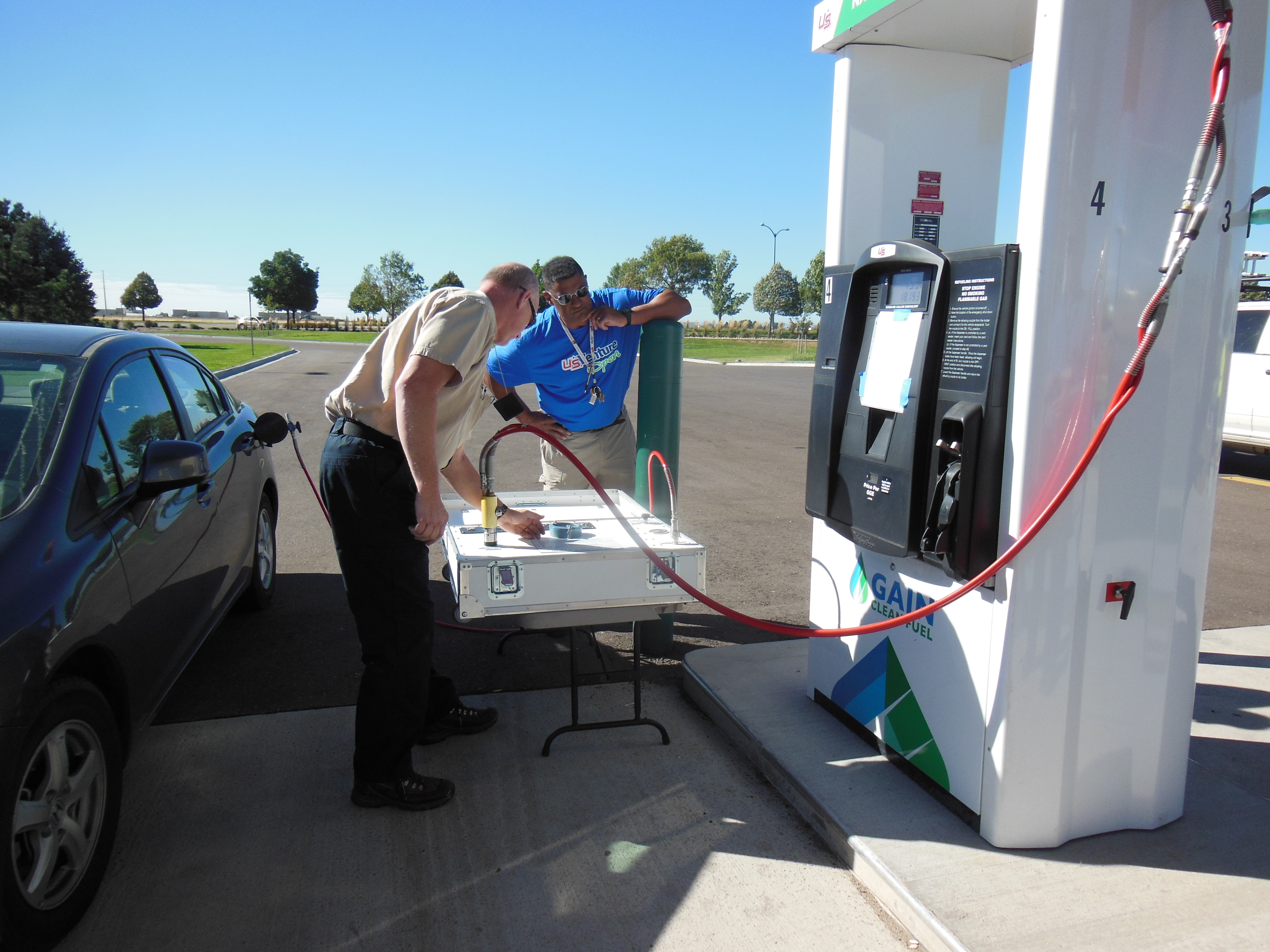 Colorado Division of Oil and Public Safety's Scott Wagner checks a readout on a device meant to check the flow of natural gas automotive fuel