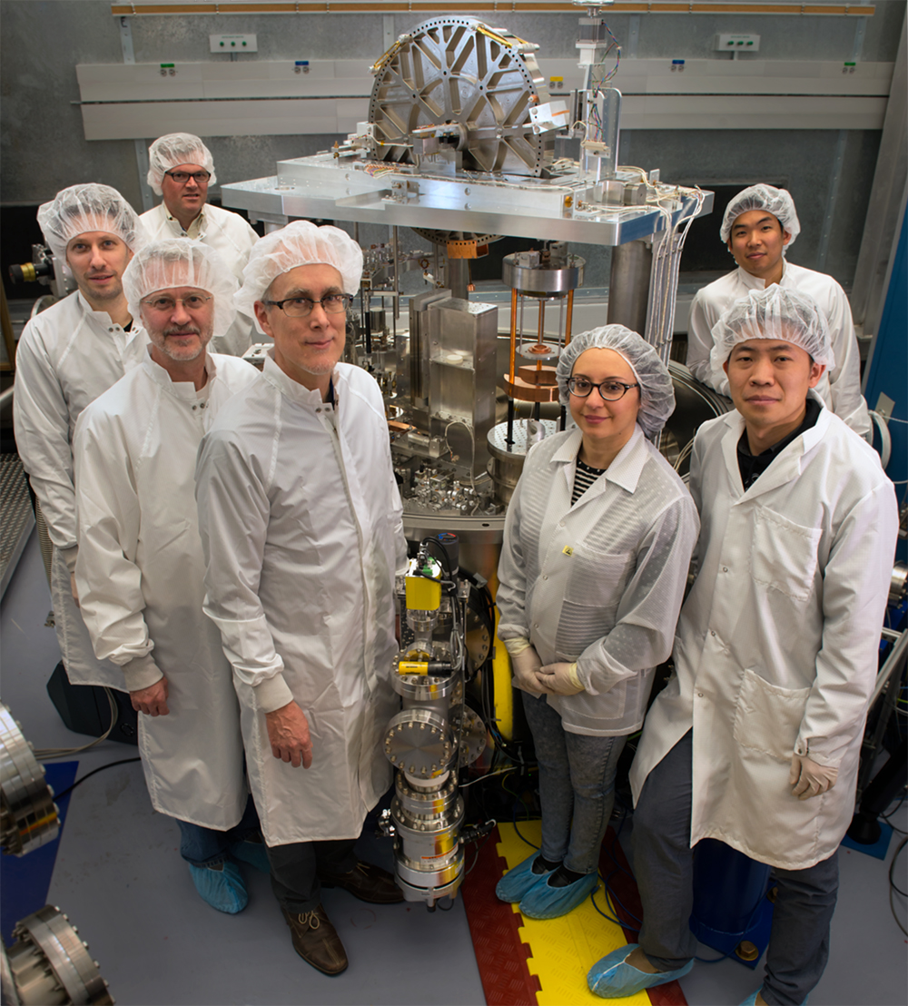 Group of scientists in clean room gear