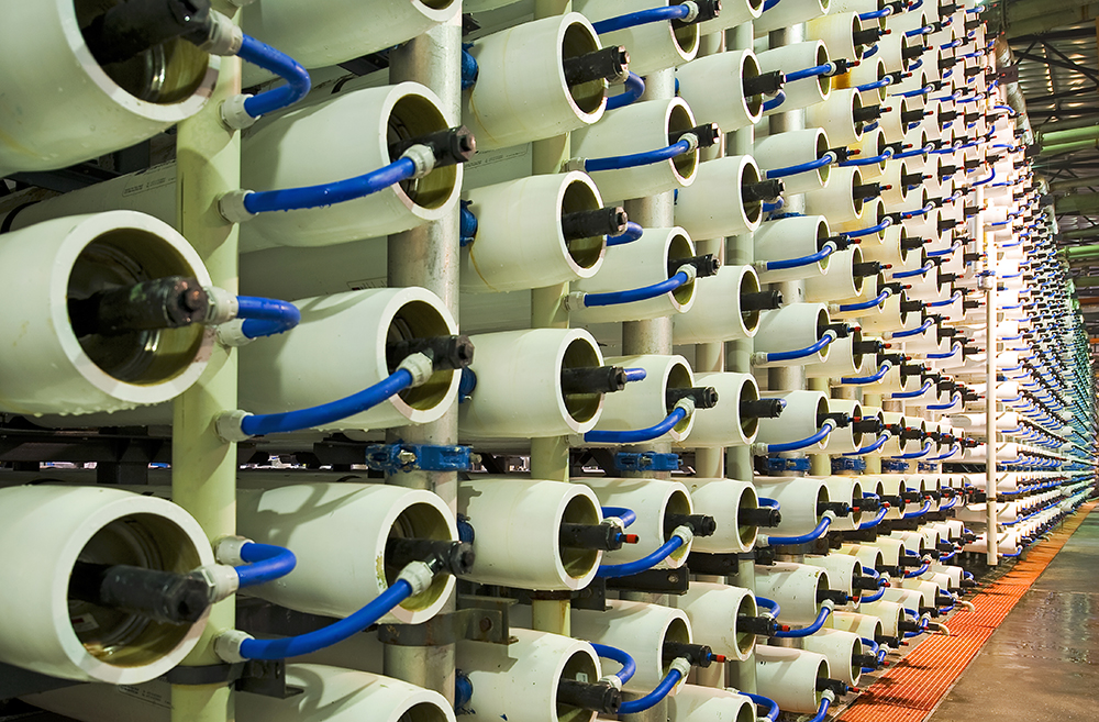 a large room of containing plastic tubes on racks with hoses attached