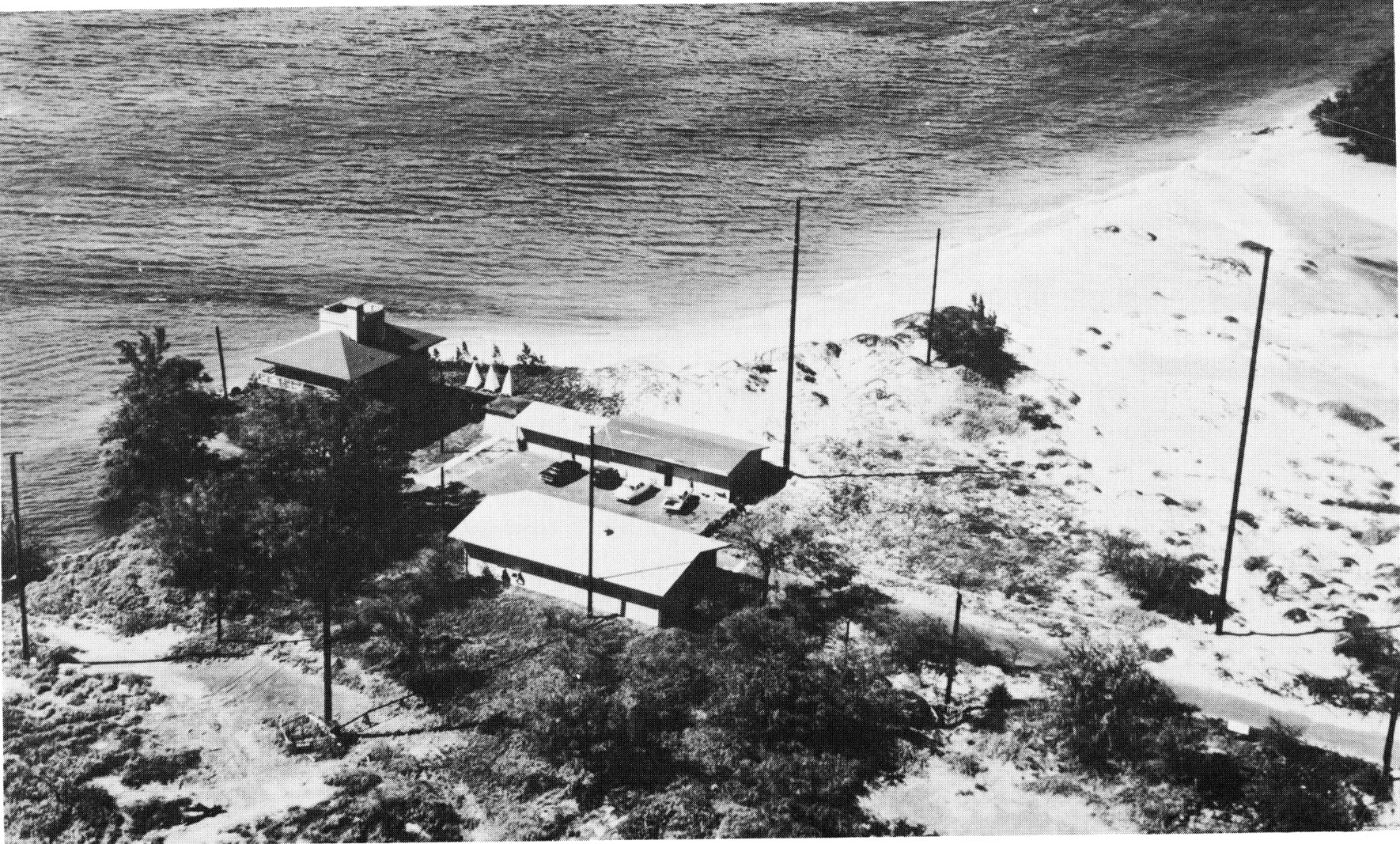 black and white image of the WWVH radio station on the very edge of the Maui shoreline