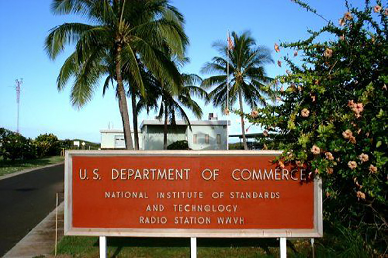 "A red sign reads ""U.S. Department of Commerce, National Institute of Standards and Technology, Radio Station WWVH"