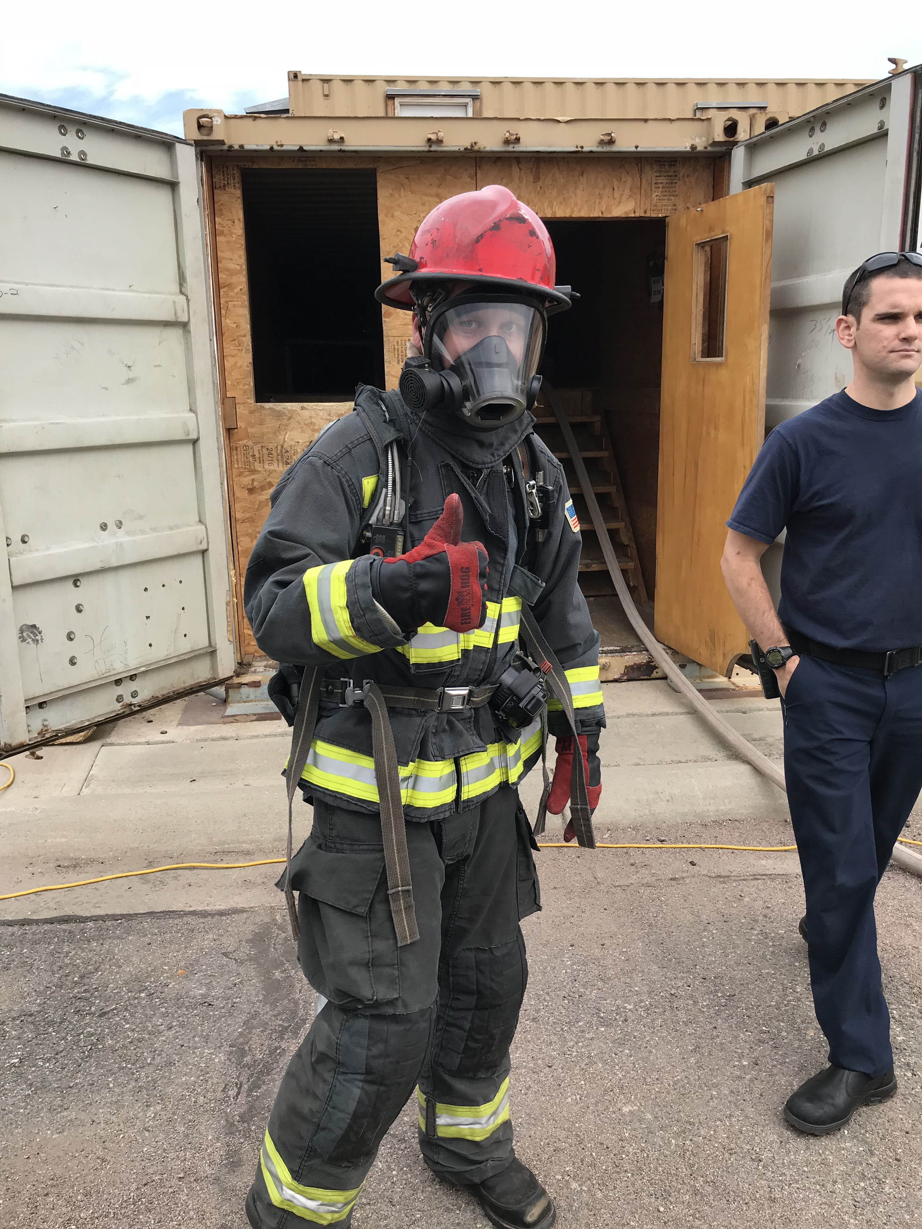 "NIST ""firefighter"" in full gear giving the ""thumbs up."""