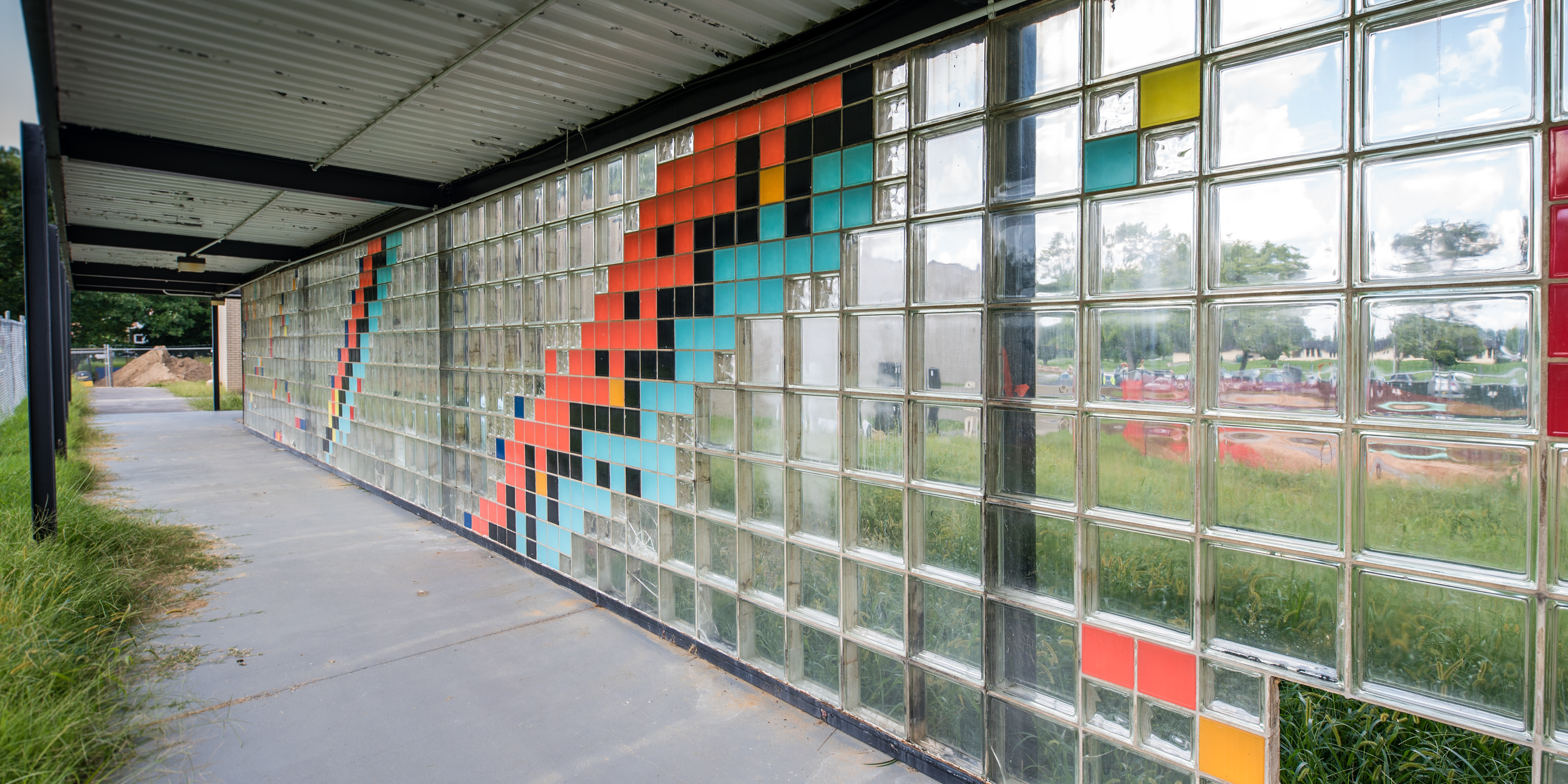 wall of multicolored glass bricks representing various isotopes