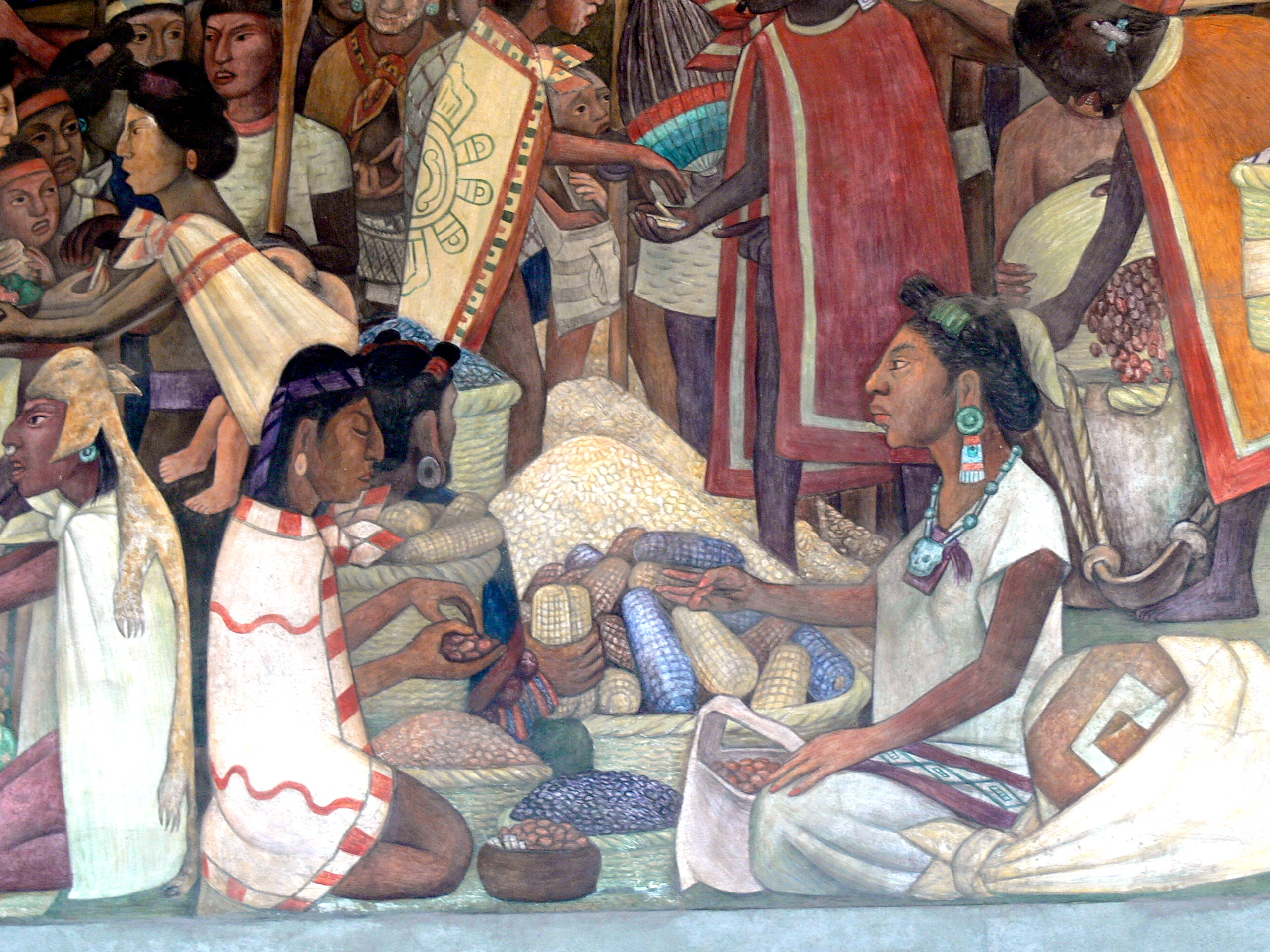 two seated Aztec merchants trading what looks like nuts