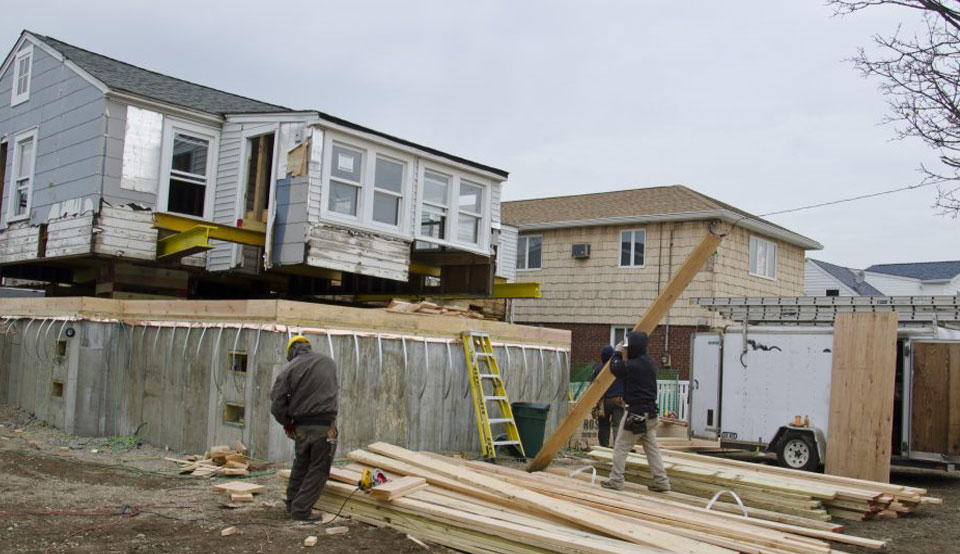 Photo of a home being raised in Seaford, NY, after Hurricane Sandy