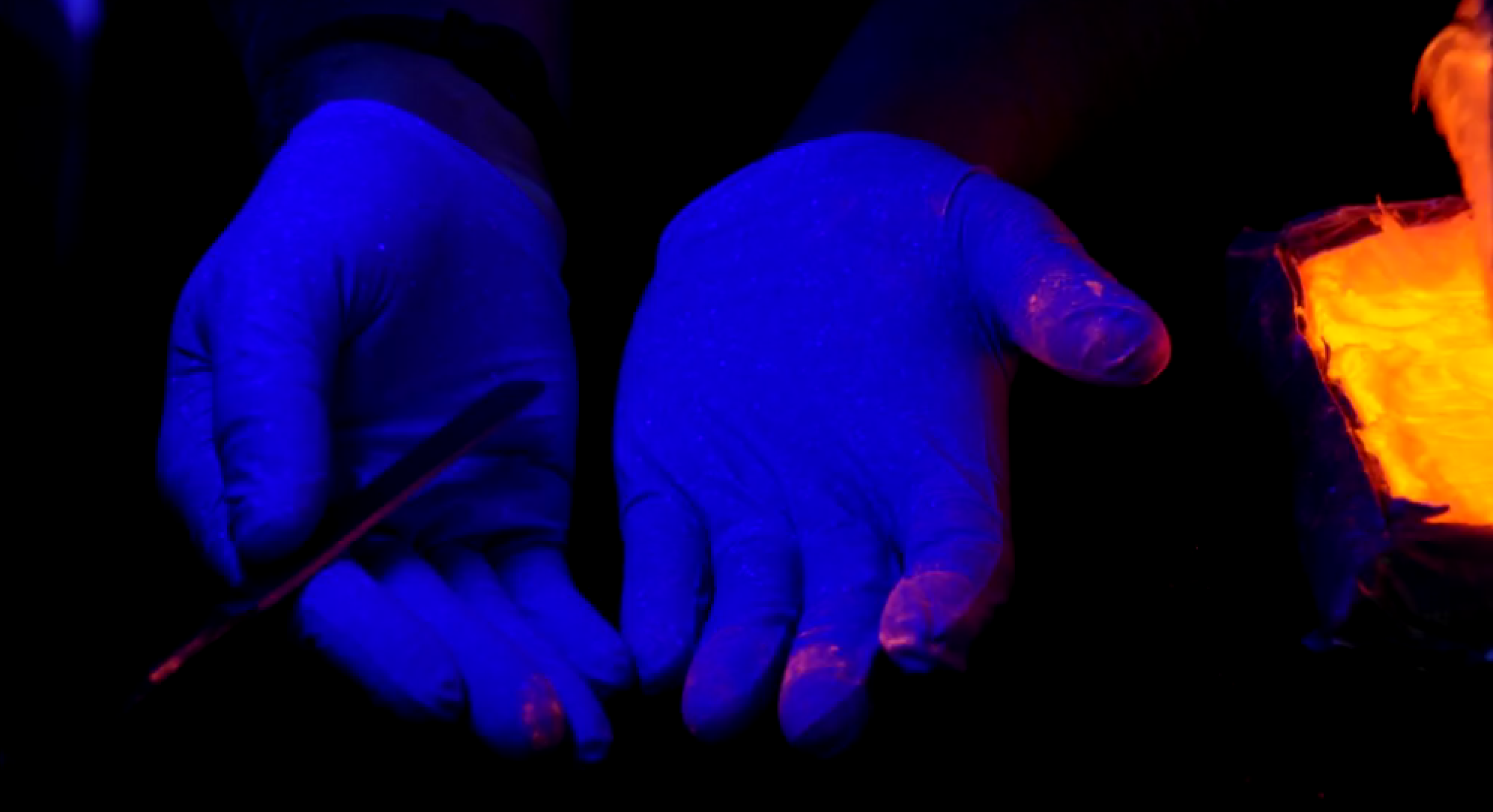 In Glowing Colors: Seeing the Spread of Drug Particles in a Forensic Lab