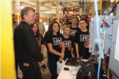 STEM students fascinated by manufacturing.