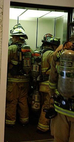 firefighters in elevator