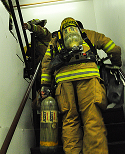 firefighters climbing stairs