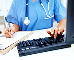 healthcare professional using computer