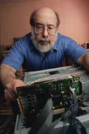 Alan Mink works on a programmable printed circuit board used to process data for the new NIST quantum key distribution system.