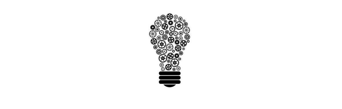 A black and white illustration of a light bulb with different sized and shaped gears as the bulb