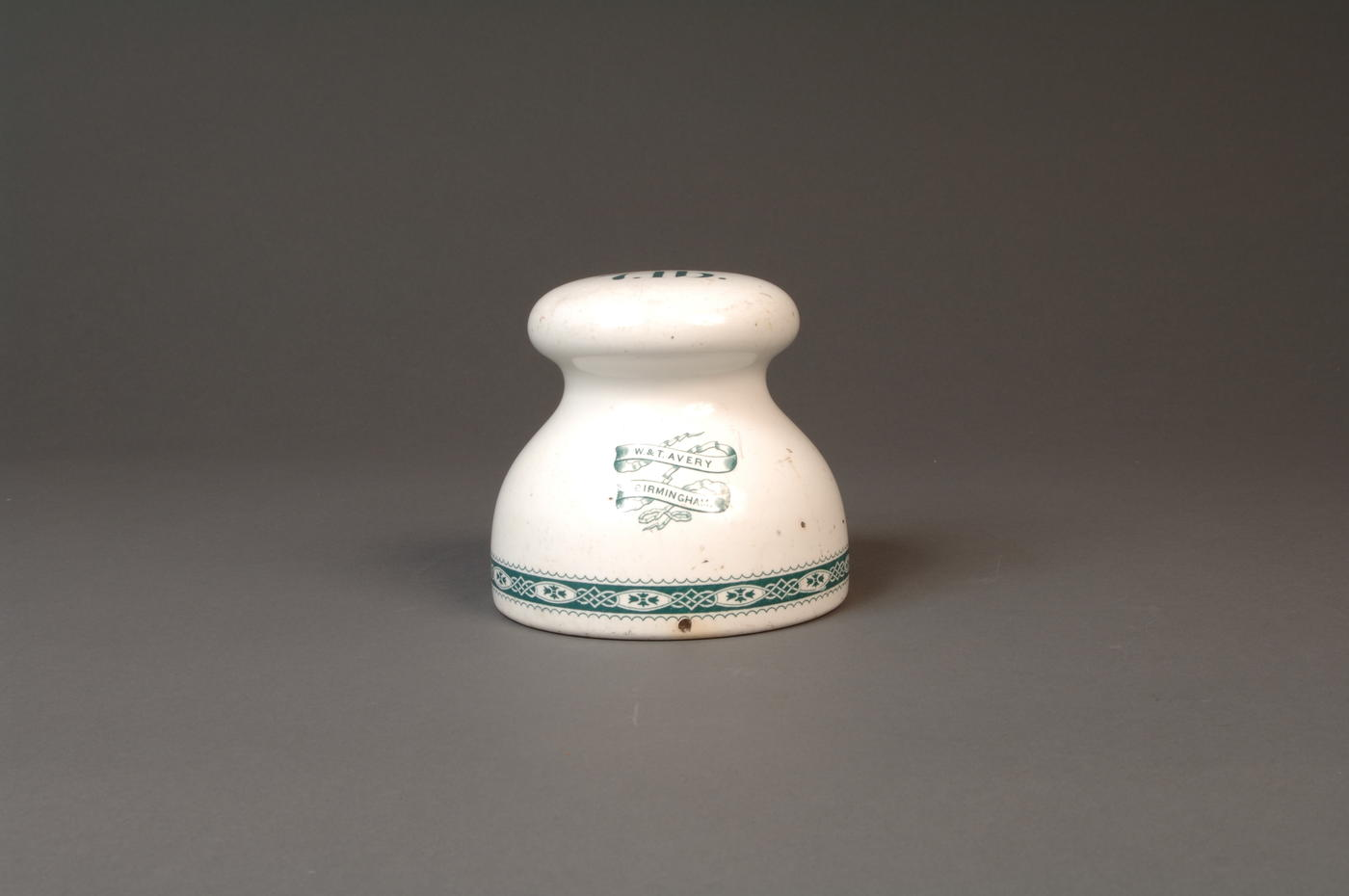Front view of white and blue Earthenware Weight