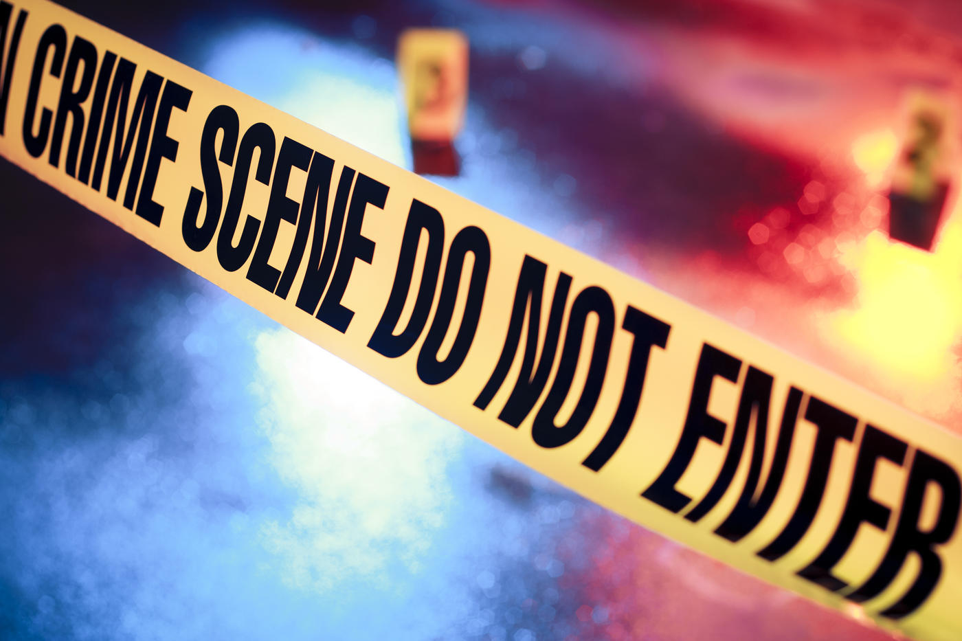 yellow crime scene tape with the words CRIME SCENE DO NOT ENTER