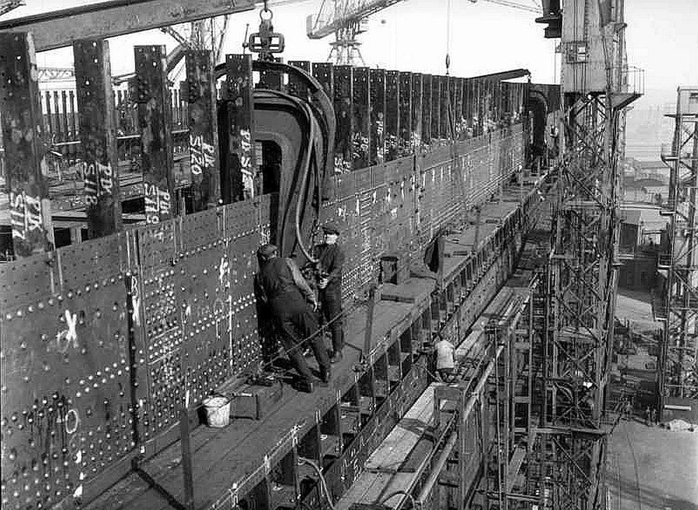 Photo of workers installing rivets in the Titanic's hull