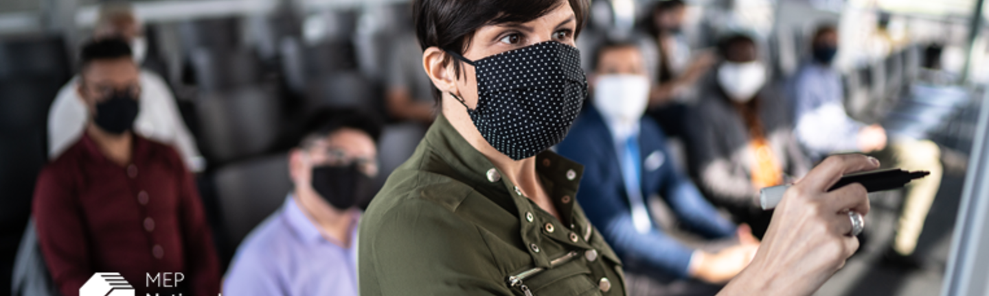 Businesswoman speaking at a business conference with face masks