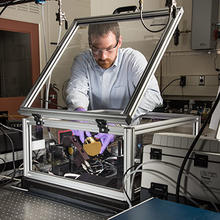 NIST researcher Chris Stafford is using a modified commercial instrument to measure the characteristics of different chemical formulations of ultra-thin sheets of plastic