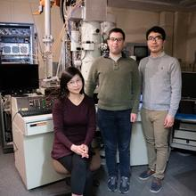 Three NIST scientist in front of transmission electron microscope