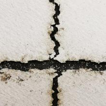 Two intersecting cracks on a solar panel backsheet.