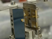Image shows an ion trap assembly used in the aluminum-ion optical clock.