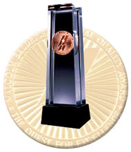 Photo of Baldrige Crystal and Medallion.
