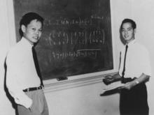 Yang and Lee in front of a chalkboard at the Institute for Advanced Study in Princeton, N.J.