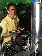 NIST physicist Jim Bergquist with the mercury ion clock
