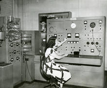 Woman uses gas analysis mass spectrometer at NBS for chemical analysis of gas or vapor mixtures