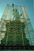 An exterior photo of the Statue of Liberty surrounded by scaffolding