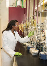 NIST research chemist Jeanita Pritchett extracts nicotine and tobacco-specific compounds from a candidate Standard Reference Material (SRM)