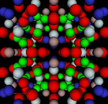 red, blue, grey, brown and blue spheres representing aluminum, lithium and copper atoms organized in a geometric pattern