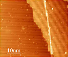 Figure 2. A STM image shows two Si(100) terraces and a single atomic step(height of 0.136nm) between them. A STM patterned a single line on the right side of terrace.