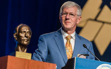 Photo of 2018 Baldrige Foundation E. David Spong Lifetime Achievement Awardee Larry Potterfield speaking at podium.