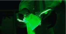 Open baggie to demonstrate particle dispersion