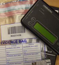 evidence bag and digital device
