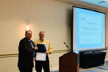 OLSS Member, Chris Plourd, being recognized at the 2019 OLSS Meeting