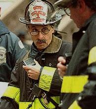 Fire fighter using a communication device.