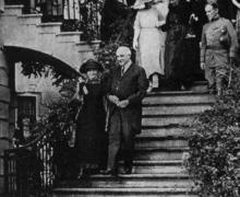 Marie Curie and President Harding on the steps of the White House