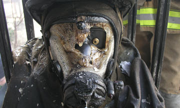 Photo of a burnt faceplate from a firefighter's gear