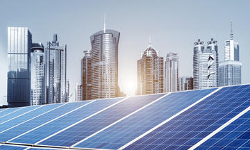 Cityscape in the background. Solar panels in the foreground.