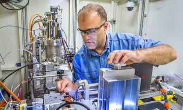 Picture of the sample area of the NIST X-ray Adsorbtion Fine Structure instrument, with NIST scientist Bruce Ravel, located at the National Synchrotron Light Source.