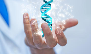 photo illustration of man in lab coat with DNA strand in his hand