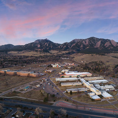 Early morning aerial view of NIST's Boulder, Colorado, campus, the Flatiron Mountains are in the background