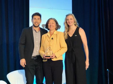 Terese Manley accepted an award from Topcoder on behalf of NIST PSCR. NIST PSCR was recognized for Public Sector Open Innovation by Topcoder.