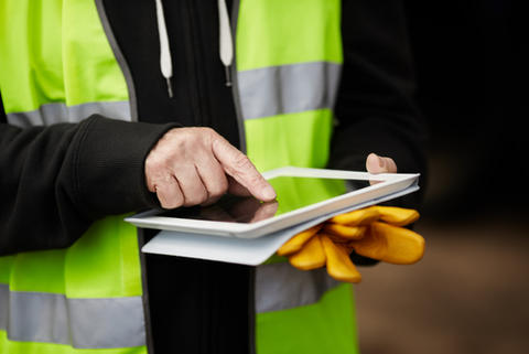 Worker holding electronic device