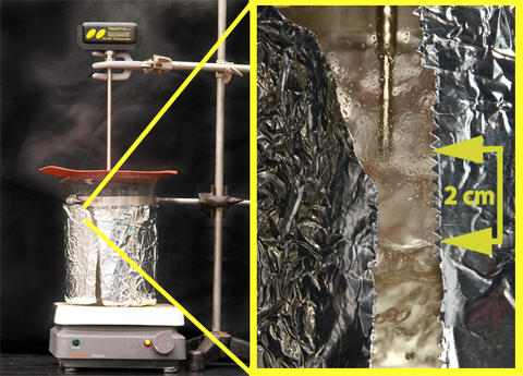Picture depicting steam verification, with the thermometer tip approximately 2 cm above the boiling water