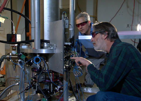 NIST physicists Steve Jefferts and Tom Heavner  with the NIST-F2 cesium fountain atommic clock